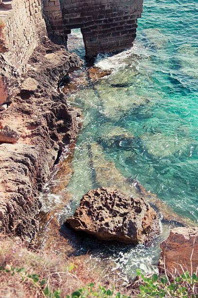 blue emerald bay in Sicily stock photo