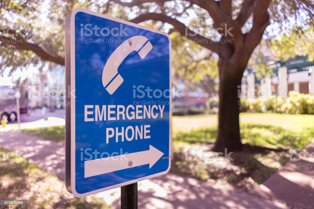 Blue Emergency Phone Sign Outside stock photo