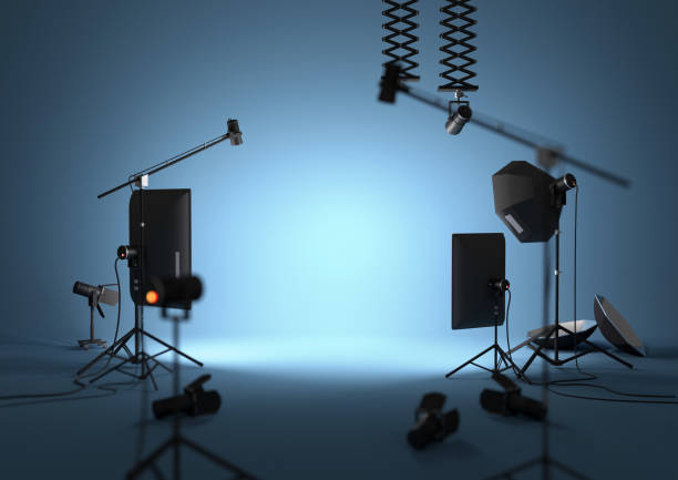 Blue Empty Photography Studio An empty blue photography studio with lighting equipment. 3D illustration photographic equipment stock pictures, royalty-free photos & images