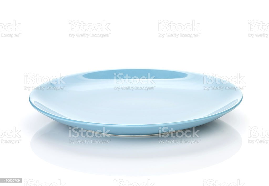 Blue empty plate stock photo