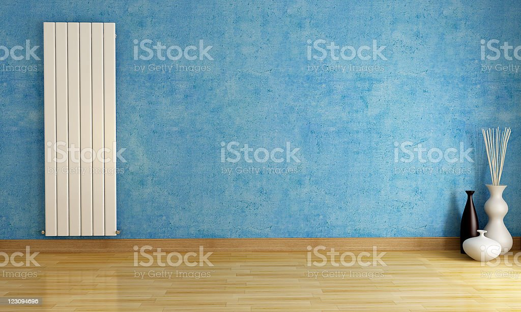 Blue empty room with radiator royalty-free stock photo