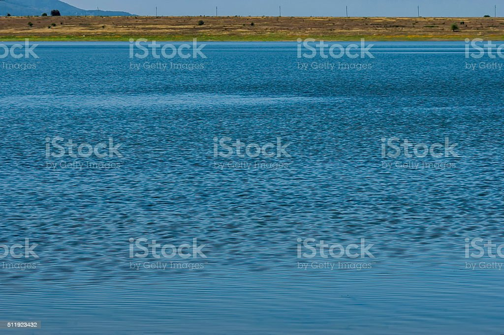 Blue empty water background - empty natural surface stock photo