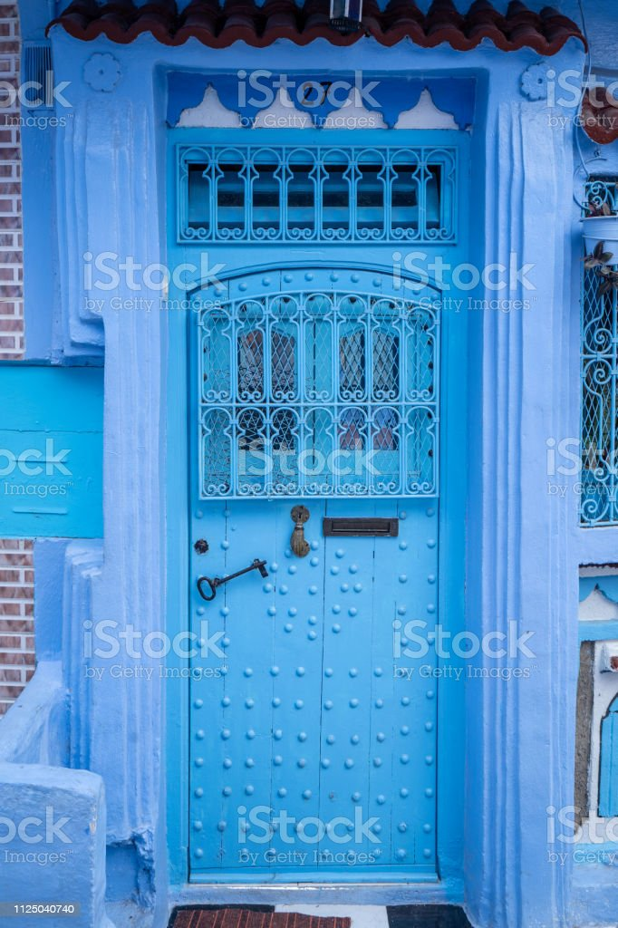 A blue entrance door at Chefchaouen in Morocco stock photo