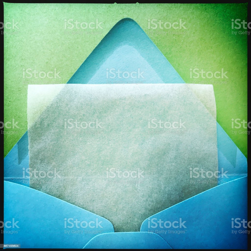 Blue Envelope with Note Paper stock photo