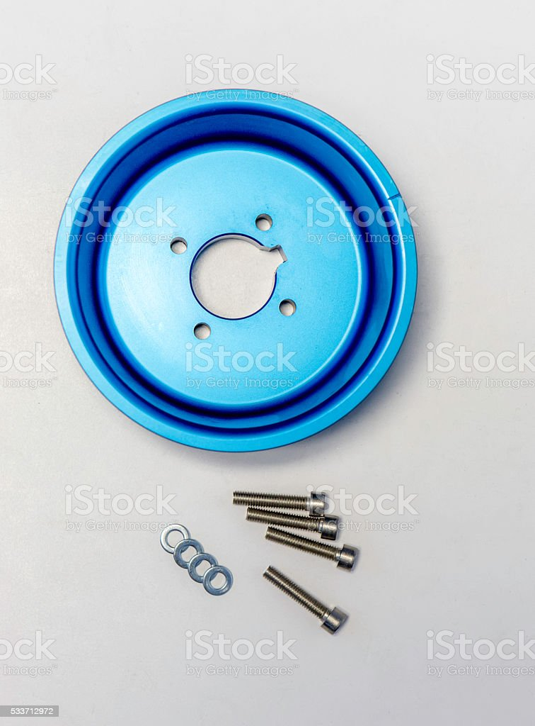 blue ergal pulley with screws stock photo