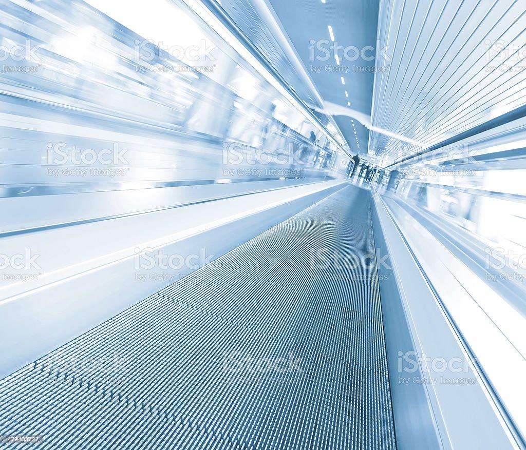 blue escalator in motion stock photo