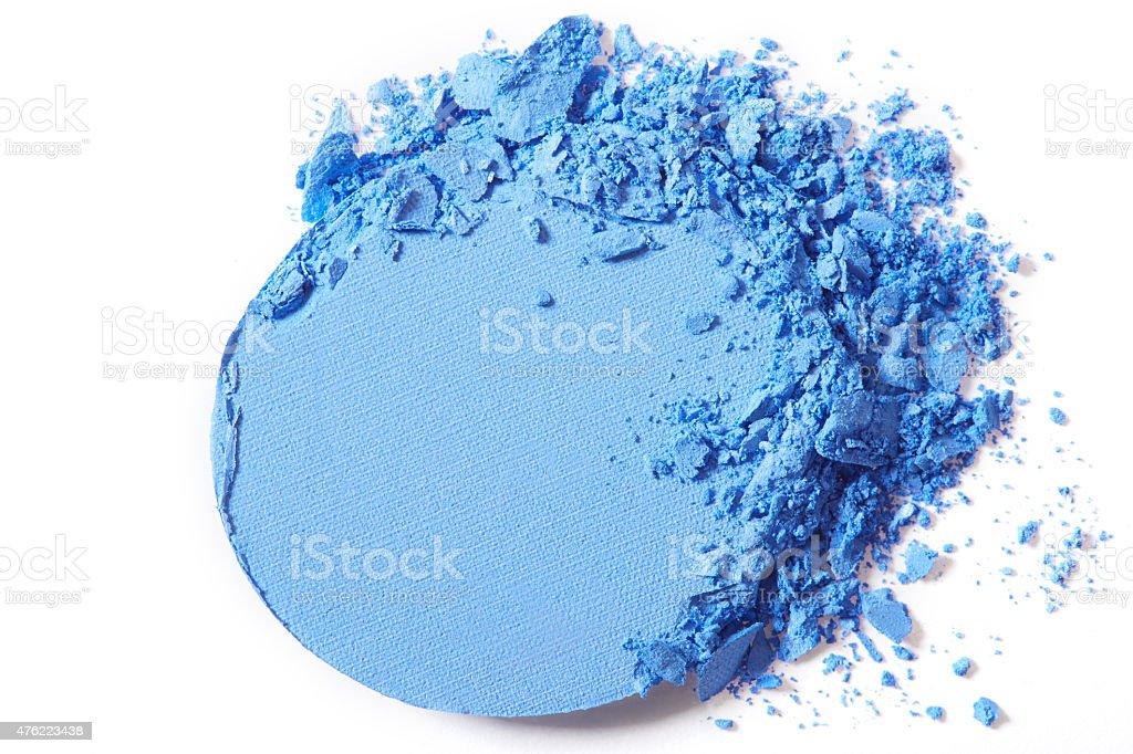 Blue eye shadow crushed on white stock photo