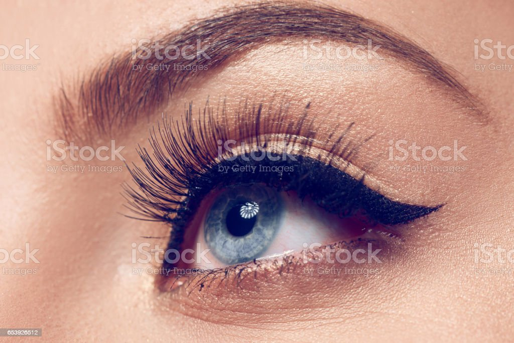 blue eye with makeup, macro shot stock photo