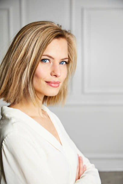 Blue eyed blond girl Blue eyed blond girl in white, portrait beautiful woman stock pictures, royalty-free photos & images