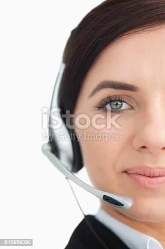 istock Blue eyed businesswoman with headset 845989090