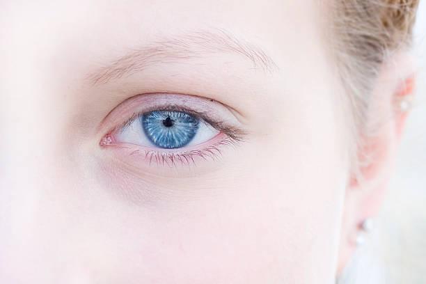 Blue eyed female stock photo