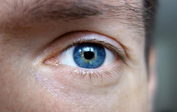 Blue eyes of a man stock photo