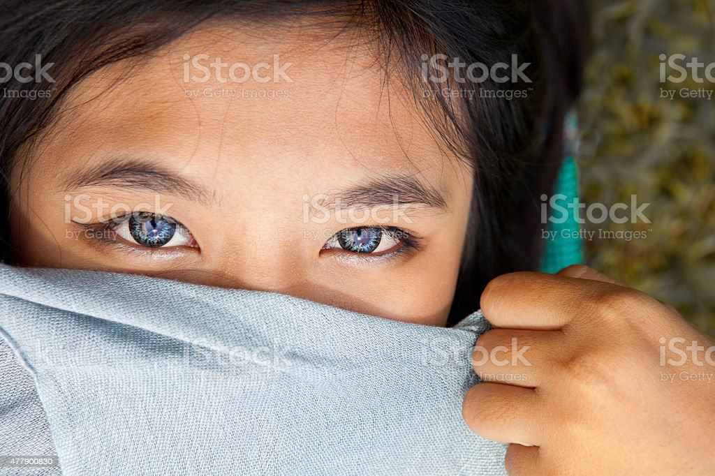 Blue eyes of asian girl using soft lens stock photo