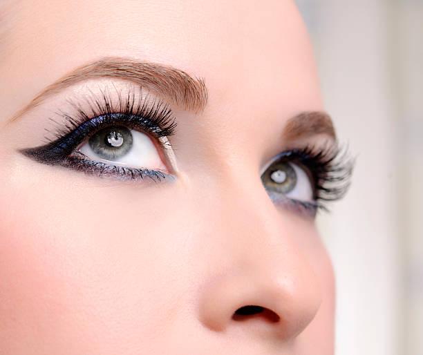 blue eyes beautiful woman blue eyes looking up. false eyelash stock pictures, royalty-free photos & images