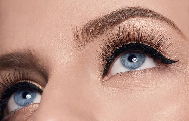 blue eyes with makeup, macro shot - Photo