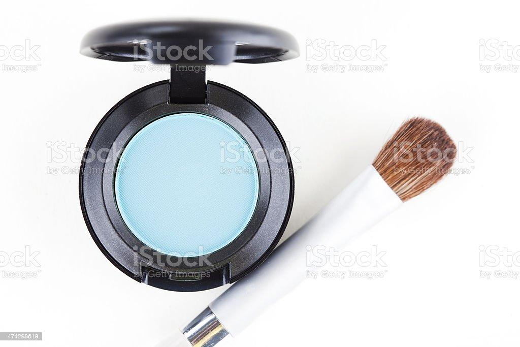 Blue Eyeshadow and Makeup Brush stock photo
