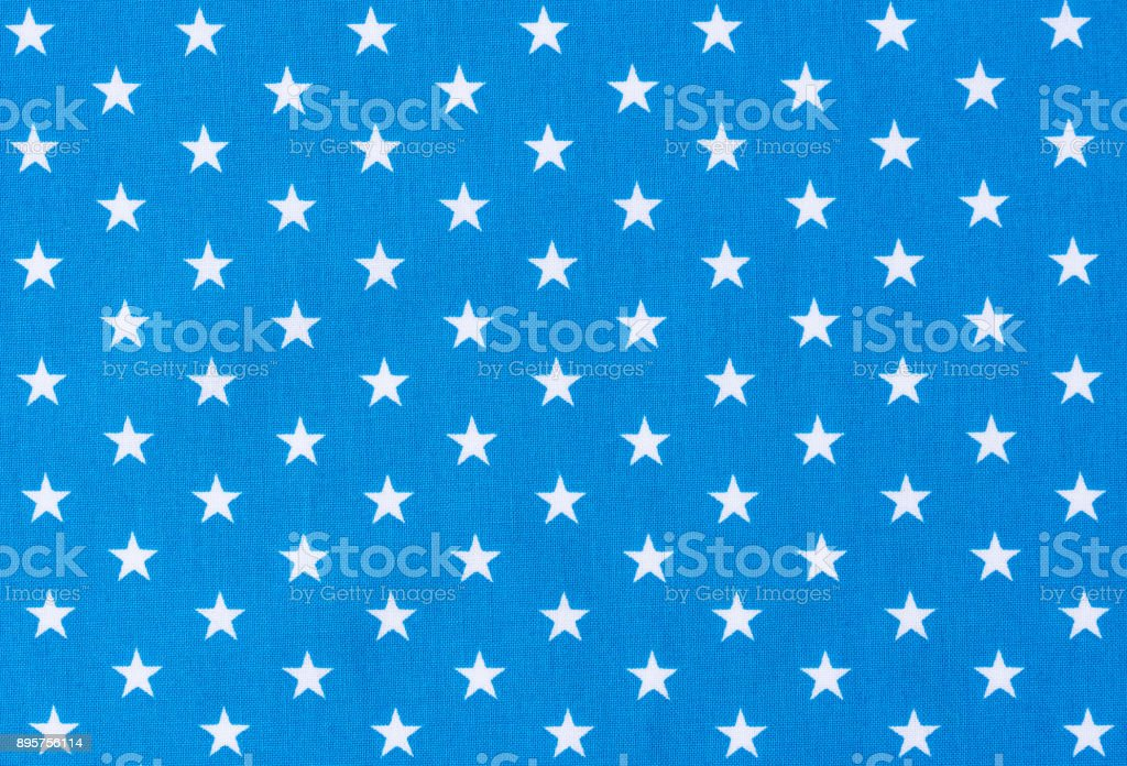 Blue fabric background texture with white star pattern stock photo