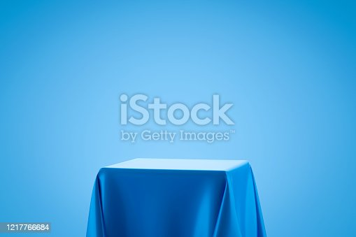 Blue fabric on podium shelf or empty studio display on light blue gradient background with art style. Blank stand for showing product. 3D rendering.