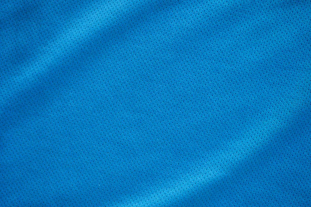 blue fabric sport clothing football jersey with air mesh texture background - nylon texture stock pictures, royalty-free photos & images