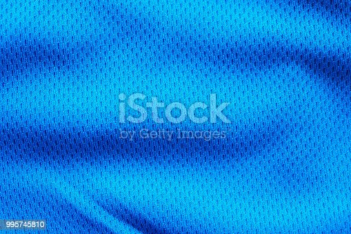 istock Blue fabric sport clothing football jersey with air mesh texture background 995745810