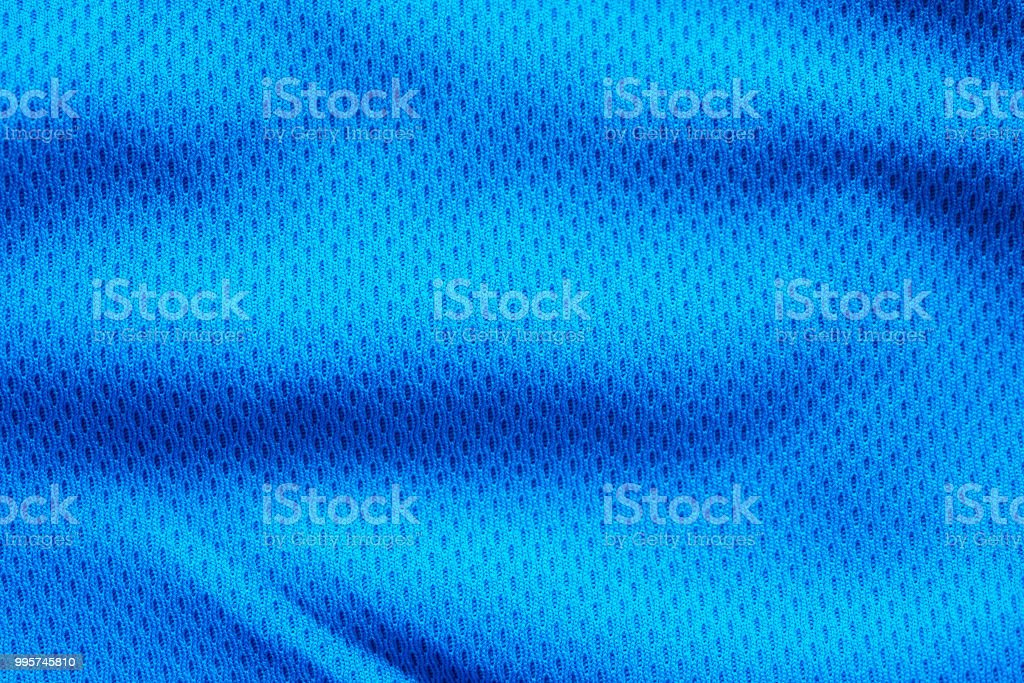 Blue fabric sport clothing football jersey with air mesh texture background stock photo