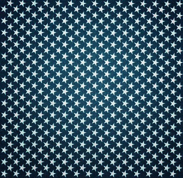 Blue fabric with white stars with vignette effect stock photo