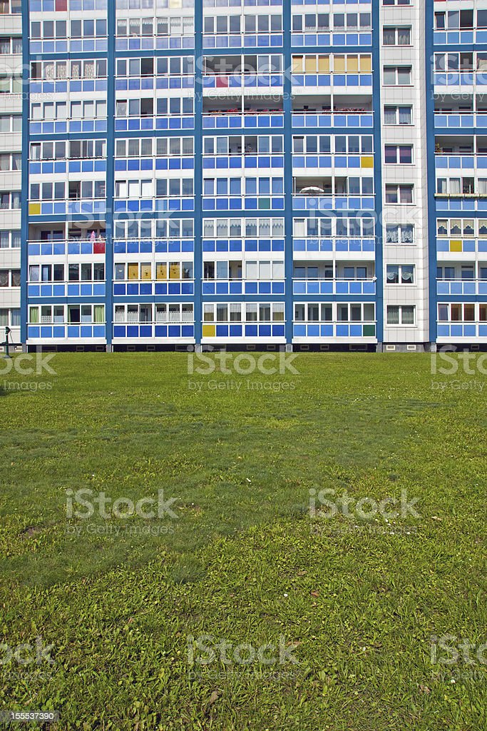 Blue facade and green grass royalty-free stock photo