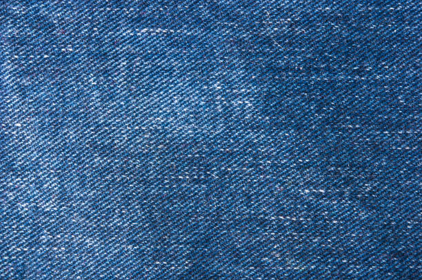 blue faded jeans texture - jeans stock photos and pictures