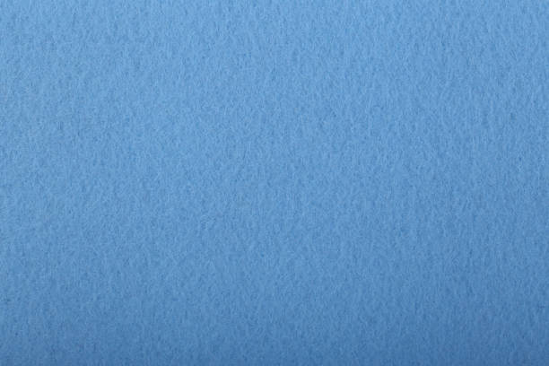 Blue felt background stock photo