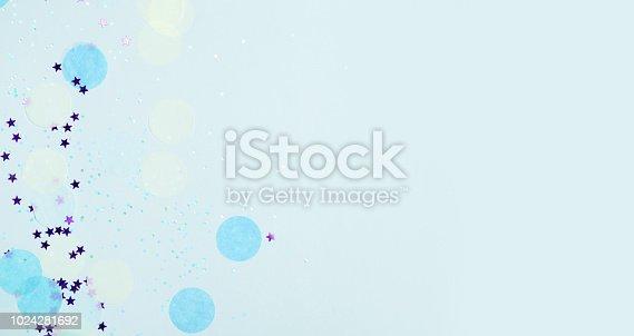 1040055260istockphoto Blue festive confetti, glitter and stars 1024281692