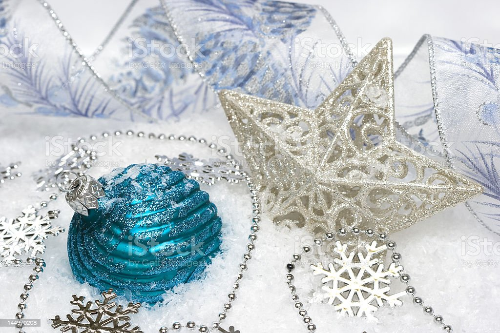 blue festive decoration and star on snow royalty-free stock photo