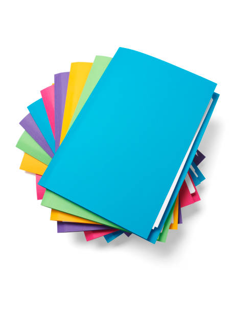 Blue File on the Top of a Pile Stack of coloured paper files. Isolated on white, with clipping path ring binder stock pictures, royalty-free photos & images