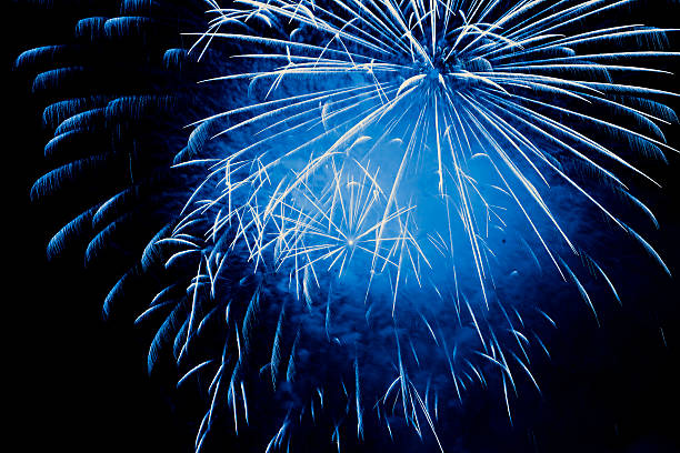 blue fireworks explosion stock photo