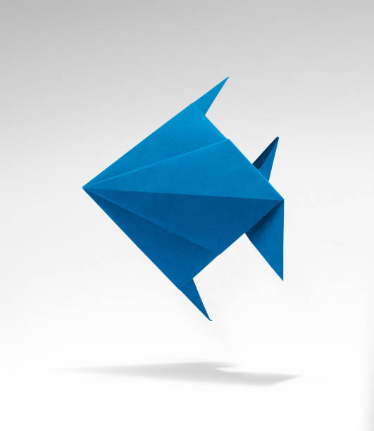 Blue fish in Origami with shadow stock photo