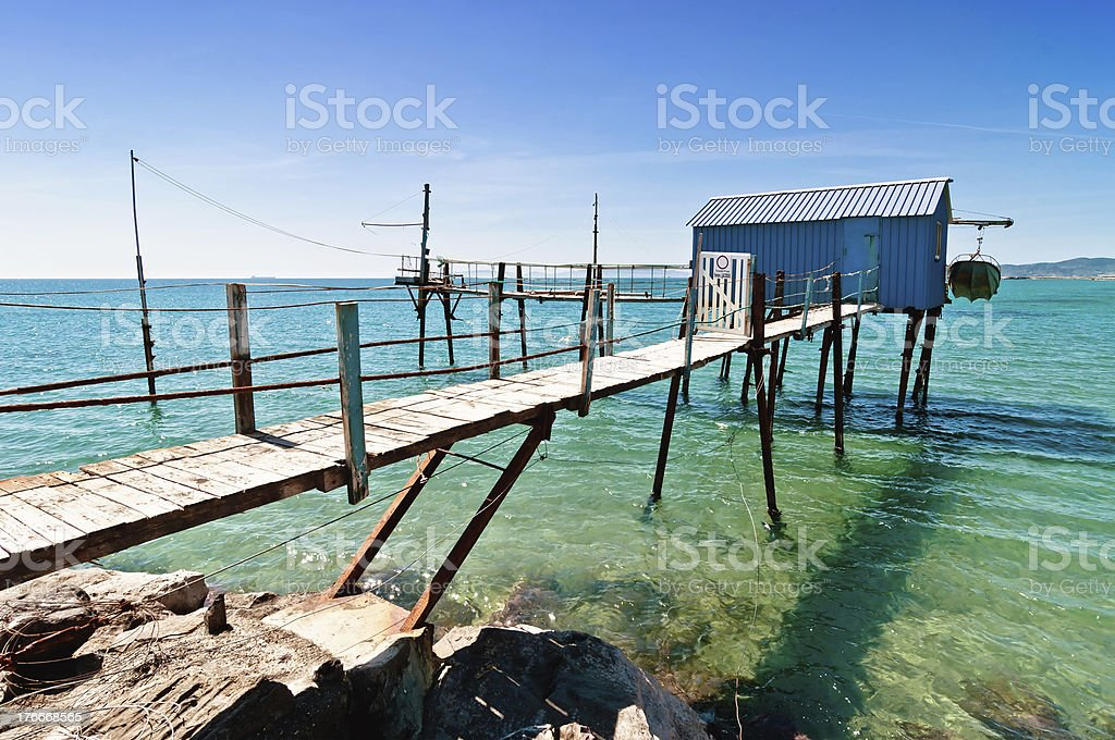 blue fishermen hut in Tuscany beach royalty-free stock photo
