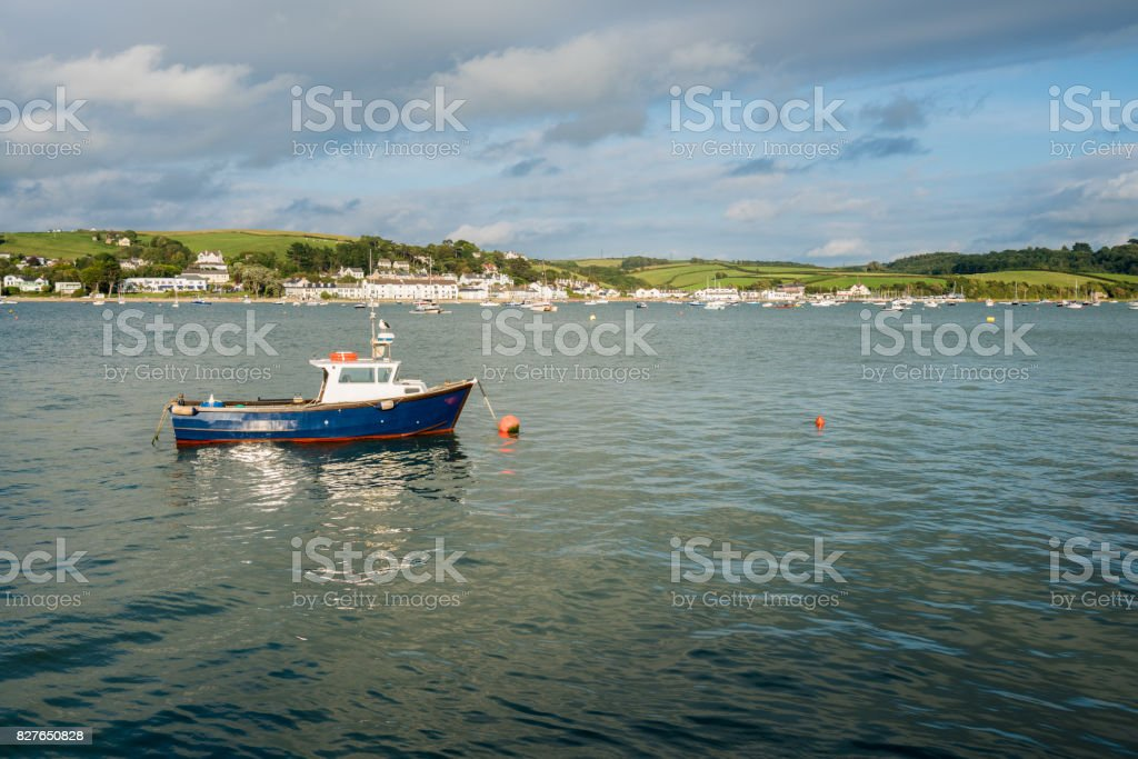 Blue fishing motor boat moored in estuary at Appledore, Devon stock photo