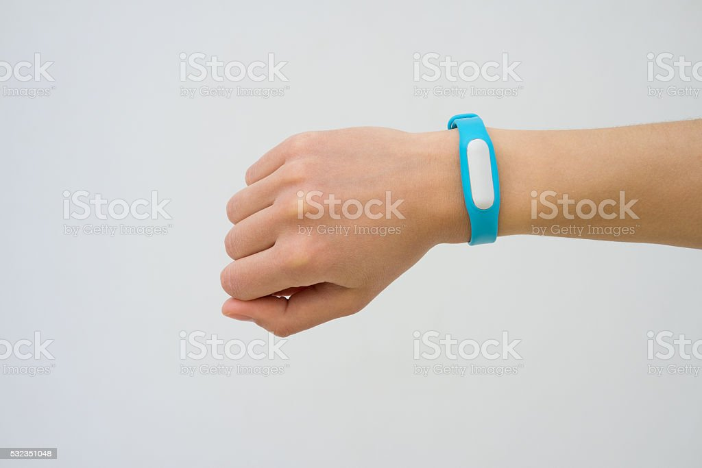 Blue fitness tracker closeup on a female hand stock photo
