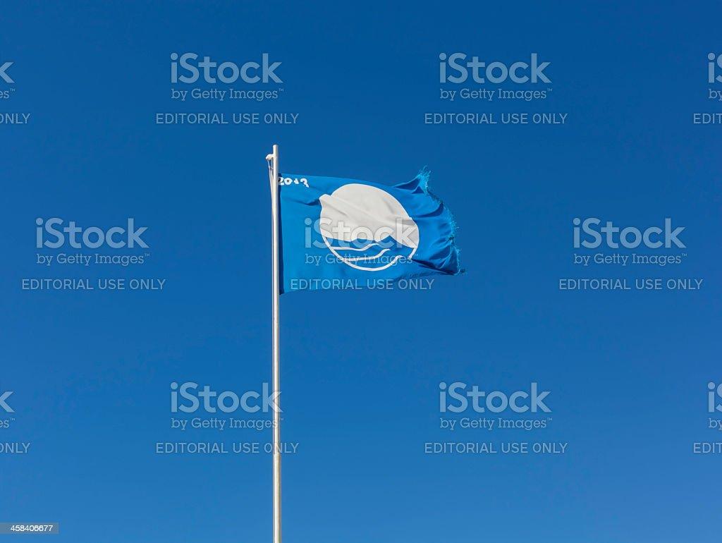 blue flag seaside award stock photo