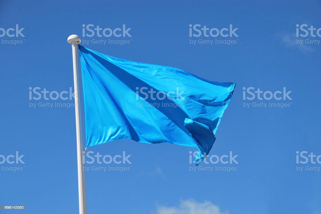 Blue flag waving stock photo