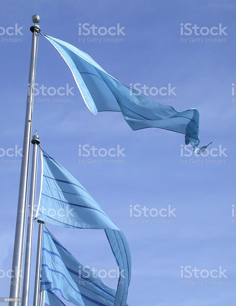 Blue flags on a Clear sky stock photo