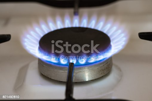 istock Blue flame coming out of natural gas stove burner. 821492810