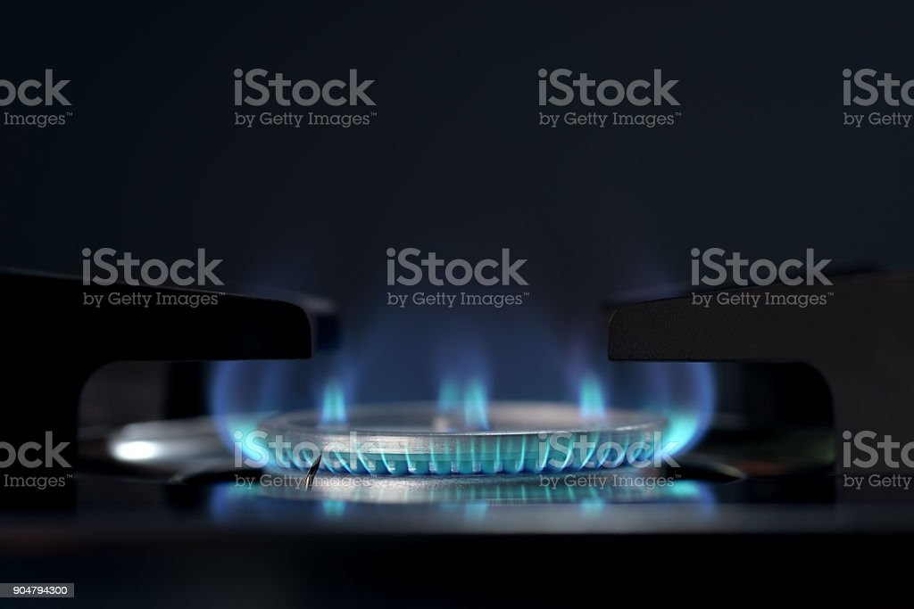 Blue flame from stove stock photo