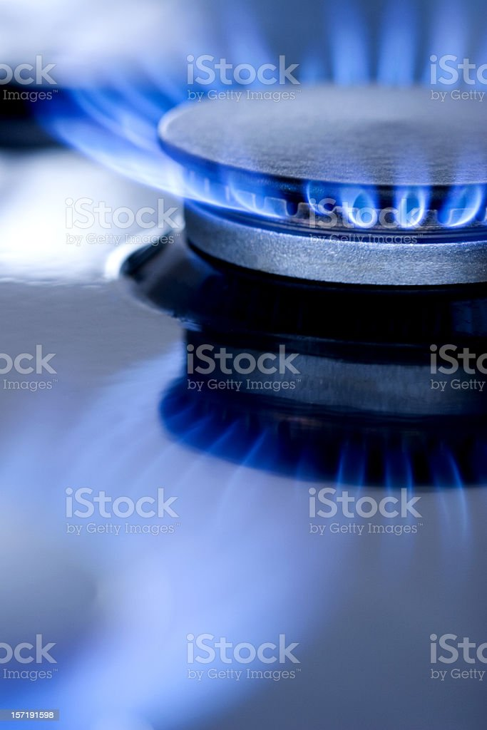 Blue flames from burner royalty-free stock photo