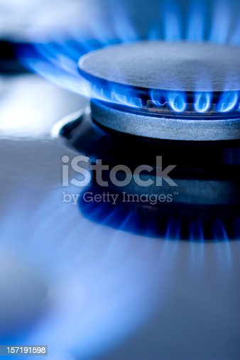 Blue flames from gas stove burner. Closeup shot of blue flames from a kitchen gas range.