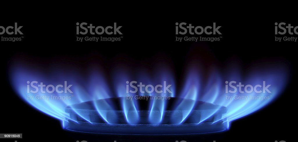 Blue Flames in Black (Gas Stove from side) royalty-free stock photo