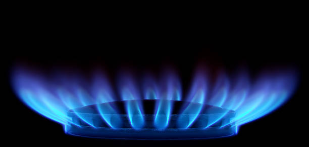 Blue Flames in Black (Gas Stove from side) stock photo