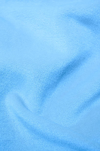 Blue flannel blanket textile background textured Blue flannel blanket textile background textured baby blanket stock pictures, royalty-free photos & images