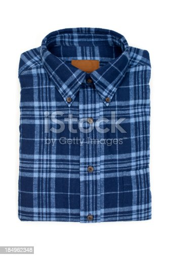 New folded man's flannel shirt, isolated on white.