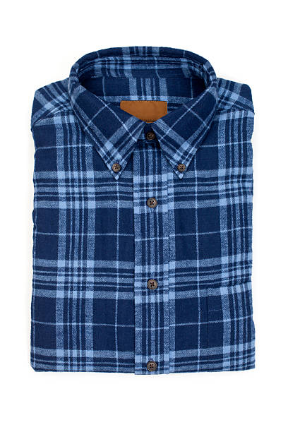 Blue Flannel Shirt New folded man's flannel shirt, isolated on white. plaid shirt stock pictures, royalty-free photos & images