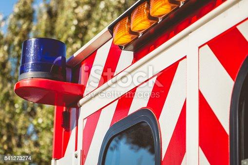 174913699 istock photo blue flashing light on a red ambulance 841273274